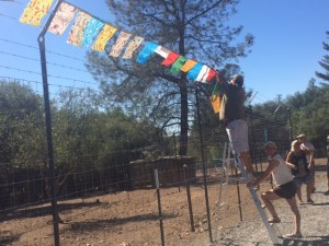 hanging prayer flags on the fence